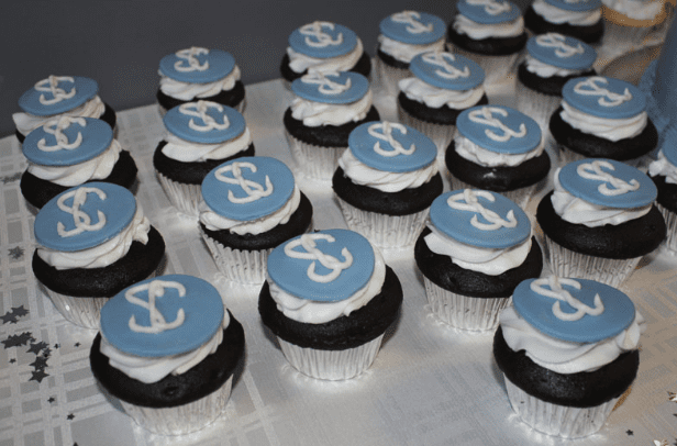 Rows of Cupcakes with Sood Center Logo Decorative Frosting