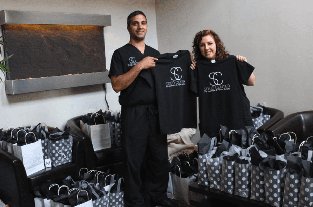 Dr. Sood and Guest Holding Sood Center Shirts