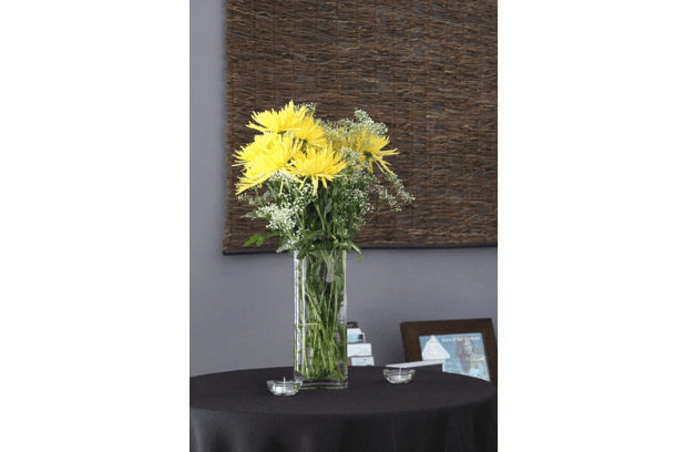 Yellow Flowers on Table for Grand Opening
