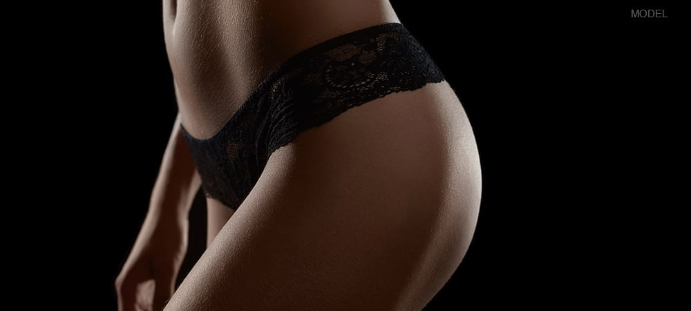 Profile Shot of Woman's Hip & Legs While Wearing Black Underwear